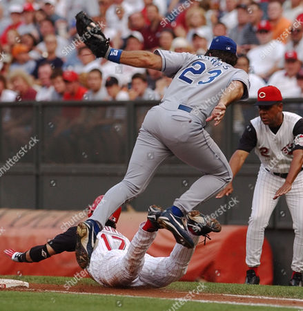 KARROS BOONE CARDENAL Los Angeles Dodgers' Eric Karros (23) jumps over Cincinnati Reds' Aaron Boone (17) as he slides safely into first base with a hit in the first inning, in Cincinnati. Coach Jose Cardenal (2) signals safe