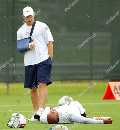 LUCAS FIEDLER Miami Dolphins quarterback Jay Fiedler, with his hand in a sling, talks to his replacement, Ray Lucas, at the start of practice in Davie, Fla. . Fiedler will miss at least one month of play with a broken thumb