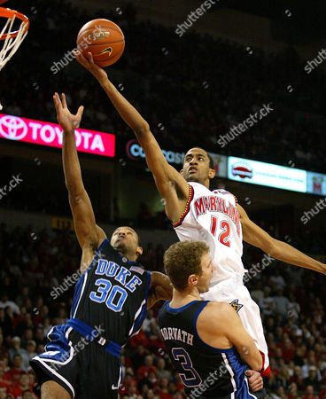 NICHOLAS JONES HORVATH Maryland's Drew Nicholas goes up for a shot over Duke's Dahntay Jones (30) and Nick Horvath during the first half at College Park, Md., . Nicholas led the Terps with 24 points in their 87-72 win over top-ranked Duke