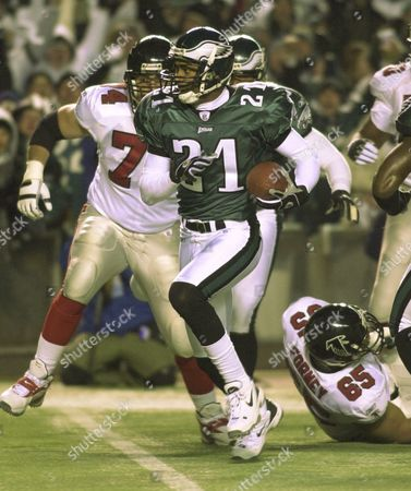 Stock Photo of WEINER TAYLOR FORNEY Philadelphia Eagles Bobby Taylor (21) returns an interception for a touchdown in the first quarter of their divisional playoff game against the Atlanta Falcons at Veterans Stadium in Philadelphia, Pa., . Falcon's Todd Weiner (74) is at left and Kynan Forney (65) is on the ground at right