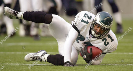 TAYLOR Philadelphia Eagles' Bobby Taylor rolls over after snagging an interception from the Seattle Seahawks in the first half, in Seattle. Taylor intercepted twice in the Eagles 27-20 victory