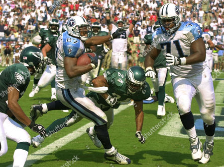 TAYLOR Tennessee Titans running back Eddie George (27) scores the game-winning touchdown on a 2-yard run as he gets into the end zone ahead of Philadelphia Eagles strong safety Blaine Bishop (24) in the fourth quarter on in Nashville, Tenn. At right is Titans tackle Fred Miller (71) and at left is Eagles cornerback Bobby Taylor (21). The Titans defeated the Eagles 27-24