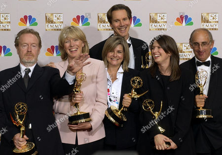 "GATHERING STORM Producers Ridley Scott, left, Julie Payne, second left, Tracey Scoffield, center, David M. Thompson, back center, Lisa Ellzey and Frank Doelger pose with the awards they won for outstanding made for television movie for ""The Gathering Storm"" at the 54th Annual Primetime Emmy Awards, at the Shrine Auditorium in Los Angeles"
