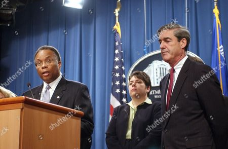 MUELLER CALDWELL THOMPSON Deputy Attorney General Larry Thompson, left, accompanied by Justice Department Enron Task Force Chief Leslie Caldwell, center, and FBI Director Robert Mueller, meets reporters at the Justice Department in Washington . They announced that Andrew Fastow, the former chief financial officer of Enron Corp. was charged Wednesday with securities, wire and mail fraud, money laundering and conspiring to inflate Enron's profits and enrich himself at the company's expense