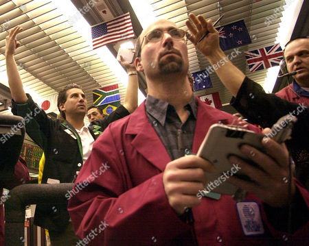 Stock Photo of WEBER Daniel Weber and other traders follow the market at the close of trade, in the Euro Currency Futures trading pit at the Chicago Mercantile Exchange. The euro hit a new three-year high against the U.S. dollar Monday in a rally that comes amid concerns over a possible war on Iraq