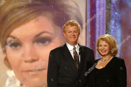 "WHITAKER GARVER Actor Johnny Whitaker, left, and actress Kathy Garver, right, from the original ""Family Affair"" smile as the audience applauds during the Family Television Awards, in Beverly Hills, Calif. The show airs Aug. 9 on ABC"