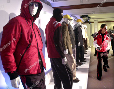 NAUTICA A showroom display of the Fall 2003 Nautica Collection by designer David Chu in New York, . A model, right, wears a Nautica Competition burn red polyester tricot bomber, a black cotton t-shirt and a black cotton knit pants