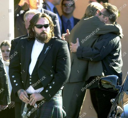 GIBB Unidentified mourners of Maurice Gibb embrace as other leave a funeral home in Miami Beach, Fla. after attending a service for the former member of the Bee Gees, who died Sunday at age 53. Man weaing kilt, left, is Stephen Gibb, son of Barry Gibb,and a nephew of Maurice