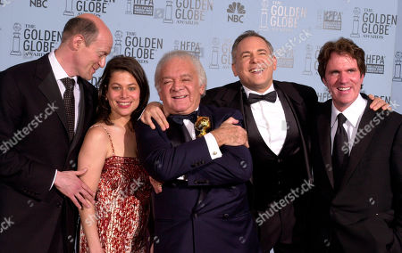 """From left, """"Chicago"""" producers Neil Meron, Meryl Poster, Marty Richards, Craig Zadan and director Rob Marshall pose after winning the award for best motion picture drama at the 60th annual Golden Globe Awards in Beverly Hills, Calif"""