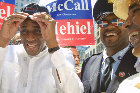 MCCALL PERDOMO Democratic gubernatorial candidate, New York State Comptroller H. Carl McCall, left, adjusts his hat before the start of the annual Dominican Day parade in New York, . Correction Officer Marcos Perdomo, second from right, looks on