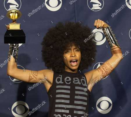 "Erykah Badu holds the Grammy for best R&B song ""Love Of My Life (An Ode To Hip Hop)"" at the 45th Annual Grammy Awards, in New York"