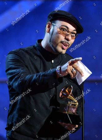 """SANCHEZ Roger Sanchez accepts the award for best remixed recording, non-classical for """"Hella Good"""" during pre-telecast of the 45th Annual Grammy Awards in New York"""
