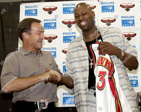 """Stock Picture of HAWKS ROBINSON KRUGER New Atlanta Hawks forward Glenn Robinson, right, is welcomed to the team by coach Lon Kruger, left, during a press conference at Philips Arena in Atlanta, . """"Big Dog"""" Robinson was obtained from the Milwaukee Bucks for Toni Kukoc, Leon Smith and one of the Hawks' two first-round picks in 2003"""