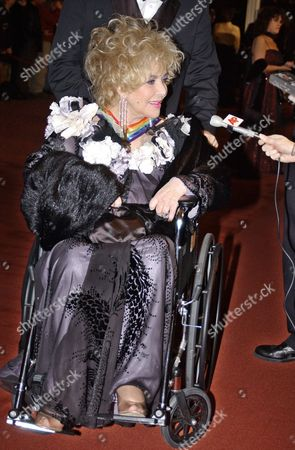 """TAYLOR Academy Award-winng actress Elizabeth Taylor arrives in a wheelchair at the Kennedy Center in Washington for a ceremony where she and four other stars from the world of performing arts were honored by the Kennedy Center for their career achievements. Taylor, 70, who became a child star with """"National Velvet"""" in 1944 and later won Oscars for """"Butterfield 8"""" in 1960 and """"Who's Afraid of Virginia Woolf"""" in 1966. Kennedy Center Chairman James A. Johnson, called Taylor """"a luminous film actress who for nearly 60 years has been a Hollywood icon treasured by millions throughout the world"""