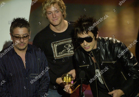 CLAVERIA FRUGONE CUEVAS Chile's La Ley, Mauricio Claveria, left, Pedro Frugone, center, and Alberto Cuevas accept their award for best rock album during the 3rd annual Latin Grammy Awards, in the Hollywood district of Los Angeles