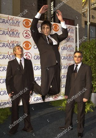 CLAVERIA The Chilean group La Ley, Pedro Frugone, left, Alberto Cuevas, center, and Mauricio Claveria pose for photographers as they arrive at the 3rd annual Latin Grammy Awards, in the Hollywood district of Los Angeles