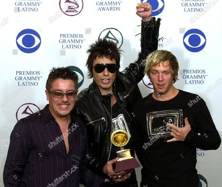 LA LEY Chilean rock group La Ley pose with the award they won for best rock album at the 3rd annual Latin Grammy Awards, in the Hollywood district of Los Angeles. From left are: Mauricio Claveria, Alberto Cuevas and Pedro Frugone