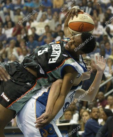 MILLER ROBINSON New York Liberty's Crystal Robinson, top, grabs a rebound over Washington Mystics' Coco Miller during the first half of Game 1 in the Eastern Conference Finals, at the MCI Center in Washington