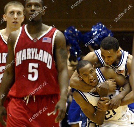 JONES Duke's Dahntay Jones, right, celebrates with teammate Chris Duhon as Maryland's Steve Blake, left, and Calvin McCall (5) walk down the court during the final seconds of the Blue Devils' 75-70 win, at Cameron Indoor Stadium in Durham, N.C