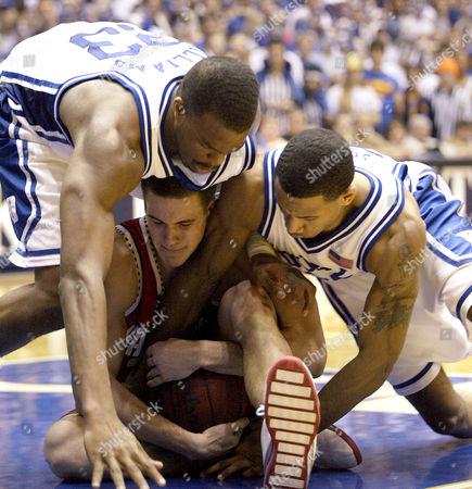 CANER-MEDLEY WILLIAMS JONES Maryland's Nik Caner-Medley, center, battles Duke's Shelden Williams, left, and Dahntay Jones, right, for a loose ball during the Blue Devils' 75-70 win, at Cameron Indoor Stadium in Durham, N.C