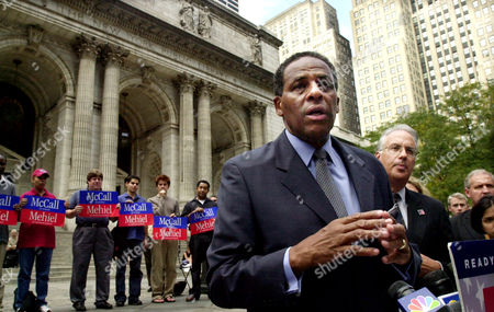 "MCCALL New York gubernatorial candidate H. Carl McCall, center, holds a press conference on the steps of the New York Public Library, . McCall criticized Governor George Pataki's education policy, saying ""our kids deserve more than an eighth grade education."" On Wednesday, McCall acknowledged that he had written dozens of letters on state stationery pitching relatives or friends for jobs or other positions but said he had done nothing wrong"