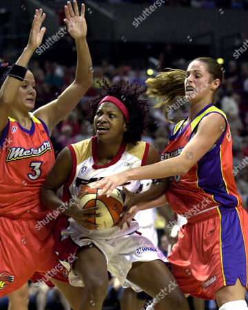 WALKER HARRISON CHRISTENSEN Portland Fire's DeMya Walker, center, attempts to drive past Phoenix Mercury's Lisa Harrison (3) and Kayte Christensen during the first half in Portland, Ore