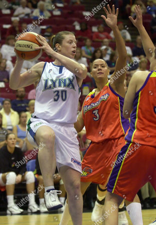 SMITH HARRISON VEAL Minnesota Lynx guard Katie Smith (30) looks to pass around Phoenix Mercury forward Lisa Harrison (3) and guard Kristen Veal, right, during the first half in Minneapolis, . Smith scored a game-high 22 points as the Lynx beat the Mercury 75-51