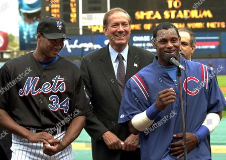 Stock Photo of PATAKI ASTACIO SOSA New York Gov. George E. Pataki, center, along with Chicago Cubs slugger Sammy Sosa, right, and New York Mets pitcher Pedro Astacio speak to reporters at Shea Stadium, in New York. The governor was joined by the baseball stars to encourage participation in an upcoming Telethon to benefit the families of Flight 587 that crashed on Nov. 12, 2001 en route to the Dominican Republic from New York