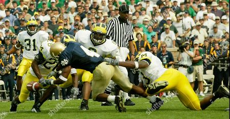 COMBS Michigan linebacker Carl Diggs, far right, forces Notre Dame tailback Ryan Grant (4) to fumble as Michigan linebacker Victor Hobson (6) and cornerback Zia Combs (31) look on in the second quarter at Notre Dame Stadium in South Bend, Ind. Michigan recovered the ball