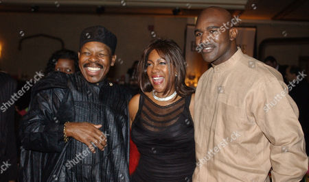 PRICE WILSON HOLYFIELD Singers, Lloyd Price, left, and Mary Wilson, of the Supremes, pose for a photograph with boxer Evander Holyfield during the reception of the 13th Annual Pioneer Awards presented by the Rhythm & Blues Foundation in New York