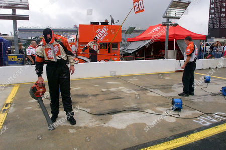 WHITE SMITH Chuck White, left, and Dale Smith, right, dry the pit area of driver Tony Stewart before the start of the UAW-GM Quality 500 race at Lowe's Motor Speedway in Concord, N.C., . The start of the race was delayed by rain for three hours