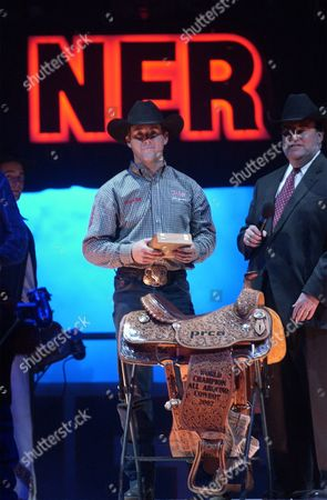 BRAZILE Trevor Brazile of Anson, Texas accepts the title of all-around cowboy from Professional Rodeo Cowboys Association (PRCA) Chairman Seven J. Hatchell, right, after the 10th and final round of the National Finals Rodeo at the Thomas & Mack Center in Las Vegas