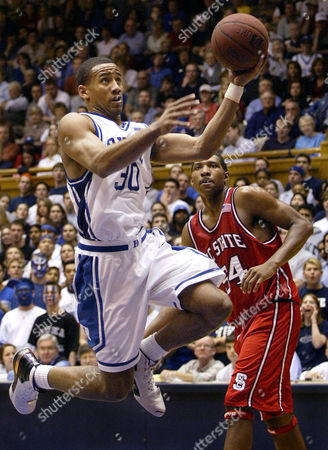 JONES MELVIN Duke's Dahntay Jones (30) drives to the basket for two of his game-high 19 points as North Carolina State's Marcus Melvin (34) looks, at Cameron Indoor Stadium in Durham, N.C.Duke won, 79-68
