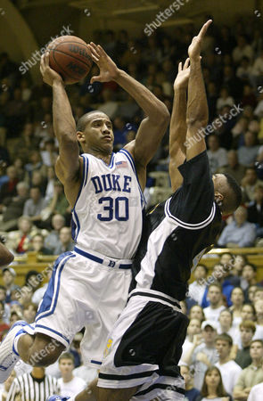 JONES PETTEWAY Duke's Dahntay Jones (30) drives to the basket against Team Nike's Napoleon Petteway, right, in the first half of their exhibition game, at Cameron Indoor Stadium in Durham, N.C