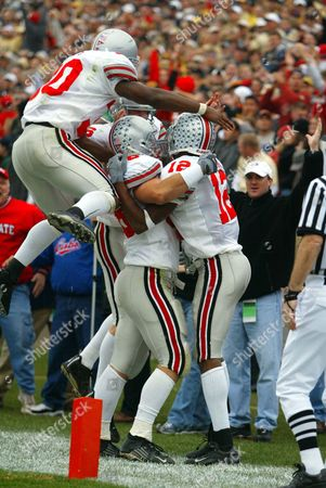 HARTSOCK JENKINS ROSS Ohio State's Michael Jenkins, right, celebrates with teammates Ben Hartsock, center, and Lydell Ross after catching a 37-yard touchdown pass from quarterback Craig Krenzel with 1:36 remaining in the game against Purdie in West Lafayette, Ind., . Ohio State defeated Purdue 10-6