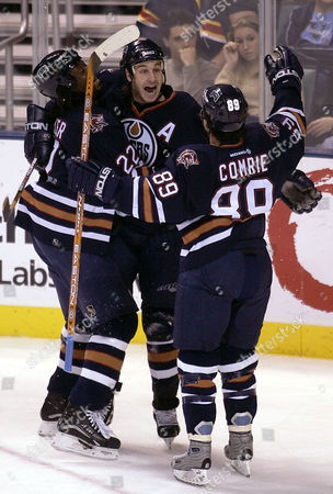SMYTH COMRIE CARTER Edmonton Oilers' Ryan Smyth, center, celebrates after scoring a goal against the Florida Panthers in the first period with teammates Mike Comrie (89) and Anson Carter, left, . In Sunrise, Fla