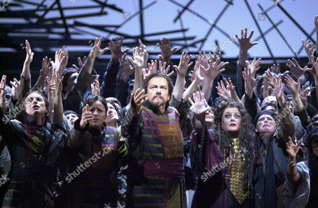 """HEPPNER VOIGT Ben Heppner, center, in the role of Aeneas, and Deborah Voigt, second from right, in the role of Cassandra, perform during part one of the dress reherasal of Hector Berlioz's opera """"Les Troyens"""" at the Metropolitan Opera in New York . To mark the 200th anniversary of the French composer's birth, the Metropolitan Opera mounted a new, uncut production of his masterwork, which premiered Monday Feb.10, 2003"""