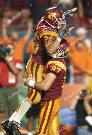 Stock Image of FARGAS MATTOS Southern Cal's Justin Fargas (25) and Grant Mattos (87) celebrate a third quarter touchdown by Fargas against Iowa at the Orange Bowl in Miami, Fla