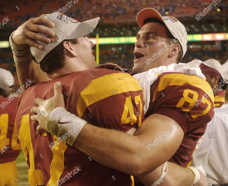 Stock Photo of MOZART MATTOS Southern California players Forrest Mozart (47) and Grant Mattos (87) celebrate their victory over Iowa in the Orange Bowl in Miami, Fla., . The Trojans beat the Hawkeyes 38-17