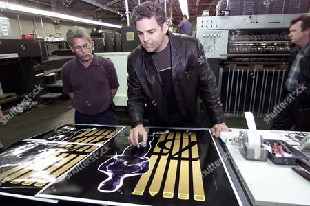 MOORE SWART With printer Mark Moore at left, graphic designer Alex Swart, center, inspects the last proofs of the poster Swart designed for the 2003 Oscars before printing in Los Angeles, . Fifty thousand copies of the poster will be printed