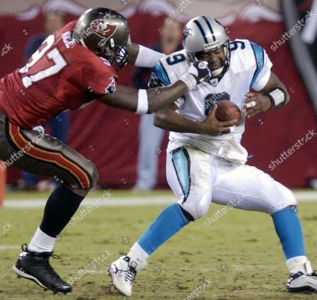 RICE PEETE Tampa Bay Buccaneers' Simeon Rice grabs Carolina Panthers quarterback Rodney Peete by the facemask during a fourth-quarter sack in Tampa, Fla. Rice was not penalized on the play. The Buccaneers won 23-10