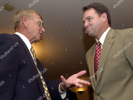 HOLTZ NUTT South Carolina coach Lou Holtz, left, talks with Arkansas coach Houston Nutt during a break in interviews with reporters at the Southeastern Conference Media Days in Birmingham, Ala., on