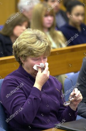 MONTAGUE Former Symbionese Liberation Army member Emily Montague, uses a tissue after being sentenced to eight years in prison, in a courtroom in Sacramento, Calif., for her part in a deadly 1975 bank robbery. Montague, along with three other former SLA members, were sentenced under a plea agreement to prison terms ranging from six to eight years in the death of Myrna Opsahl during a bank robbery in Carmichael, Calif