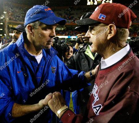 ZOOK Florida head coach Ron Zook, left, greets South Carolina head coach Lou Holtz, left, at midfield following Florida's win over South Carolina, 28-7,, in Gainesville, Fla