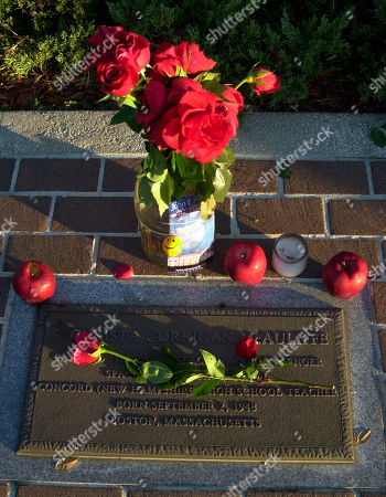 MCAULIFFE Red roses and apples lay on a plaque remembering teacher Christa McAuliffe, who perished in the 1986 explosion of the space shuttle Challenger, in Titusville, Fla., . Like Challenger, 17 years and four days earlier, the end for Columbia came in a tremendous burst of light. In Challenger's case, the capsule housing the astronauts was hurtled 8.7 miles to the sea below. Columbia was 38 miles high over Texas when it was enveloped in flame on Saturday