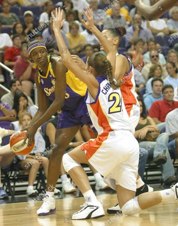 MILTON, CHRISTENSEN, HARRISON Los Angeles Sparks' DeLisha Milton, left, looks to pass as Phoenix Mercury's Kayte Christensen, center, and Lisa Harrison defends during the first half in Phoenix