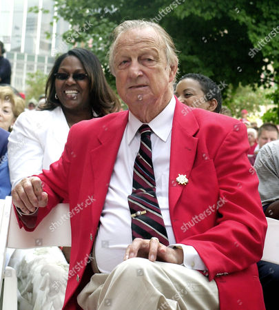 """MUSIAL Stan Musial, watches during the ceremonies and unveiling of a statue in honor of the former St. Louis Cardinals shortstop and fellow Baseball Hall of Famer Ozzie Smith . Musial known as """"Stan the Man,"""" one of the best major league baseball players is 81 years-old and played 22 seasons with the Cardinals"""