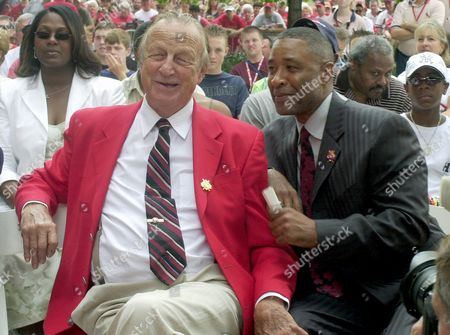 """SMITH MUSIAL Stan Musial, left, jokes with Ozzie Smith during the unveiling of a statue in honor of Smith . Both Musial and Smith are members of the Baseball Hall of Fame. Musial is known for his red jacket and most baseball fans refer to him as """"Stan the Man"""