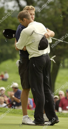 Stock Photo of BARNES HAAS Ricky Barnes of Stockton, Calif., left, hugs Bill Haas of Greer, S.C., Saturday, August, 24, 2002, at the U.S. Amateur at Oakland Hills in Bloomfield Hills, Mich. Barnes defeated Haas 1-up on the final hole to advance to Sunday's final against Hunter Mahan