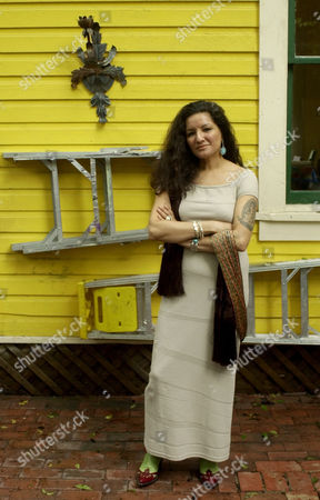 """CISNEROS Author Sandra Cisneros poses for a photo in San Antonio, . """"You can't get famous in Texas,"""" she writes in her new novel, """"Caramelo,"""" but the 48-year-old Cisneros defies that theme as her fame grows from coast to coast"""